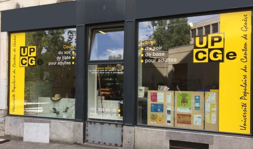 Déco sur vitrines de l'Université Populaire. Création du visuel, réalisation en adhésif permanent découpé.